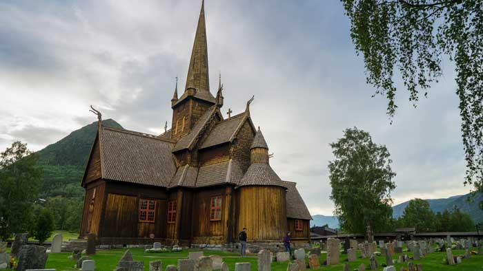 Lom Stave Church Biker Girl Adventure riding Norway